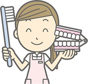 歯ブラシ持つ歯科衛生士