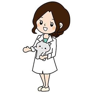猫を抱く看護師