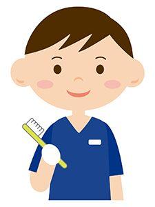 歯ブラシを持つ歯科医師